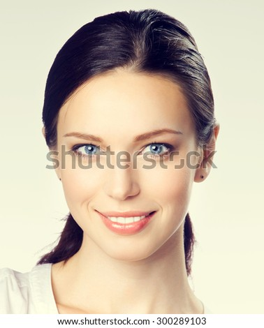 Portrait of smiling young attractive businesswoman - stock photo
