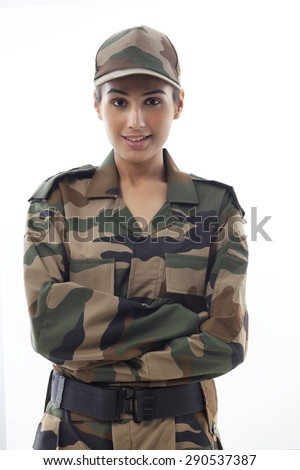 Portrait of smiling young female soldier against white background - stock photo