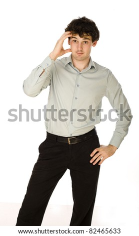 Portrait of smiling young man wishing you good luck over white background - stock photo