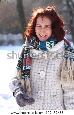 Portrait of  smiling young woman in a winter park - stock photo