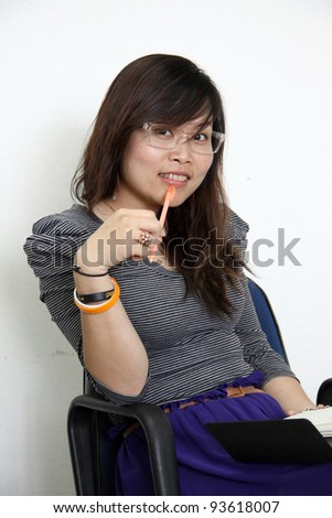 Portrait of smilling asian woman - stock photo