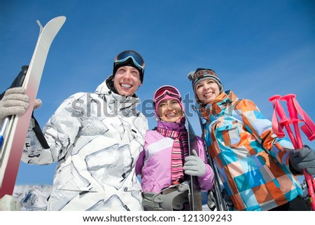 Portrait of smilling young couple in winter park - stock photo