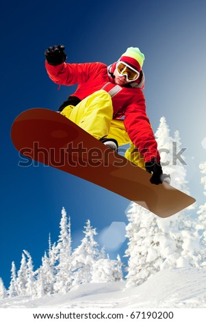 Portrait of snowboarder doing extreme trick - stock photo
