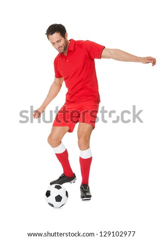 Portrait of soccer player. Isolated on white - stock photo