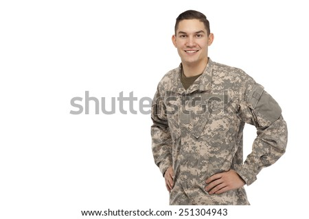 Portrait of soldier posing with hands on hips - stock photo