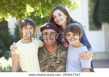 Portrait Of Soldier Returning Home With Family - stock photo