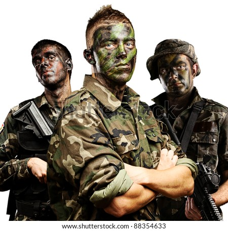 portrait of soldiers group with jungle camouflage over white - stock photo