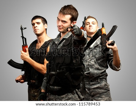Portrait Of Soldiers On Grey Background - stock photo