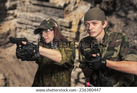 Portrait of soldiers up in arms - stock photo