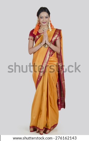 Portrait of South Indian woman greeting - stock photo