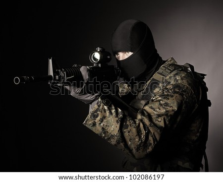 portrait of special force soldier in action - stock photo