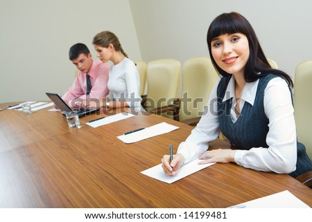 Portrait of specialist sitting at the table at business briefing - stock photo