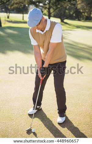 Portrait of sportsman playing golf on a field - stock photo