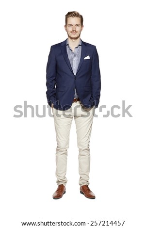 Portrait of standing young man. Isolated on white.  - stock photo