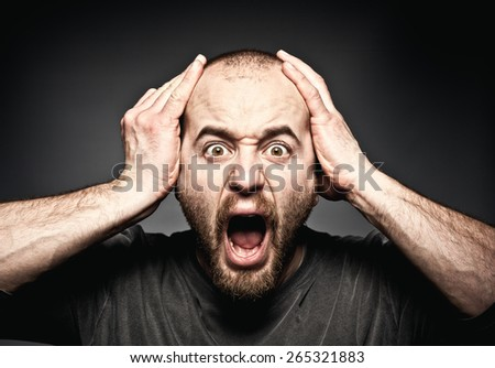 portrait of stressed man face - stock photo