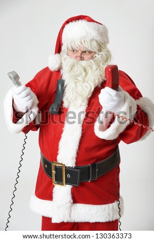 portrait of stressed santa clause on the phone - stock photo