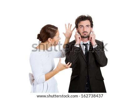 Portrait of stressed young couple going through hard times in relationship, isolated on white background. Upset, angry wife, girlfriend trying to explain something to annoyed man, who closes ears. - stock photo