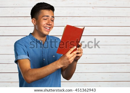 portrait of student with a book - stock photo