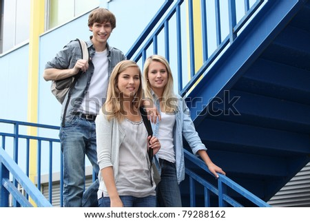 portrait of students in stairs - stock photo