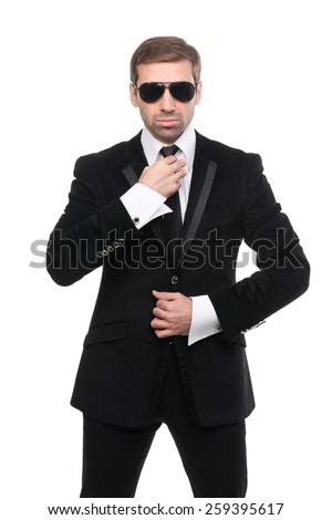Portrait of stylish bodyguard with sunglasses. Isolated over white background - stock photo