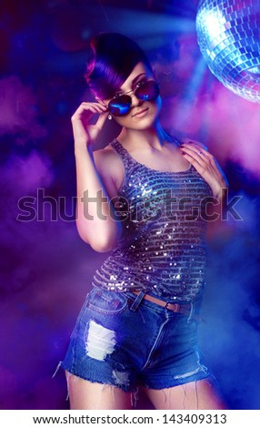 Portrait of stylish girl on disco party at the night club - stock photo