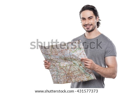 Portrait of stylish handsome young man isolated on white background. Man smiling and holding map - stock photo