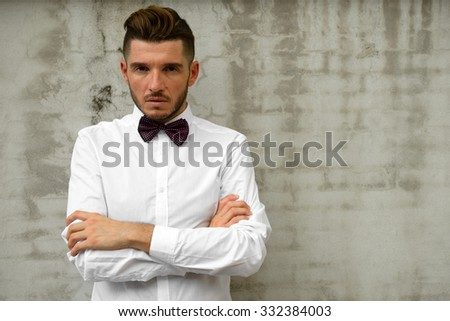 Portrait of stylish man wearing necktie - stock photo