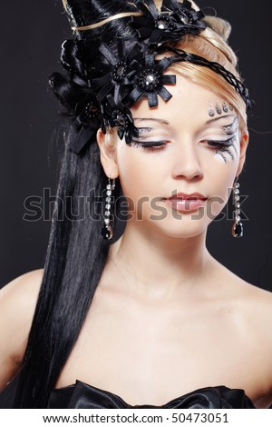 Portrait of stylish woman with fantasy hairstyle and make-up - stock photo