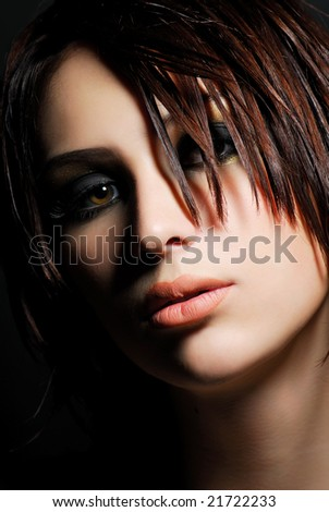 Portrait of stylish young adult girl. Creativity make-up and hairstyle - stock photo