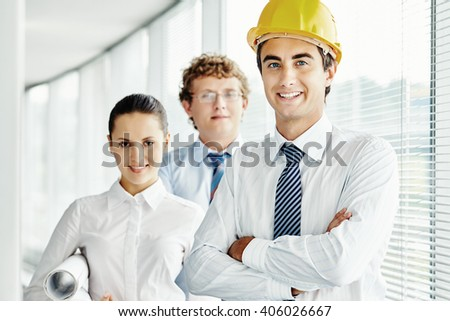 Portrait of succesful team of architects - stock photo