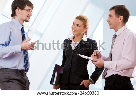 Portrait of successful business partners discussing new ideas at meeting - stock photo
