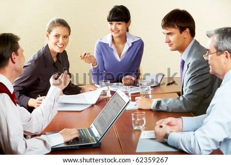 Portrait of successful business people sitting at the table and brainstorming - stock photo