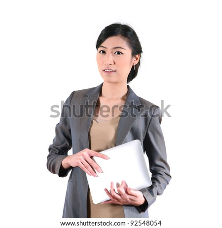 Portrait of successful business woman carrying laptop. - stock photo