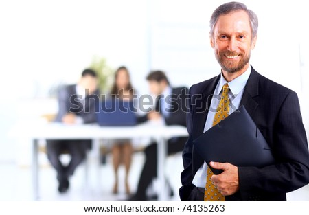 Portrait of successful businessman and business team at office - stock photo
