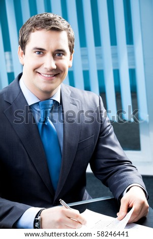 Portrait of successful businessman at office - stock photo