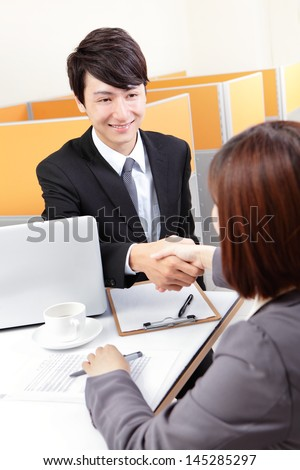 Portrait of successful businessman at the interview shaking hands at office, asian people - stock photo