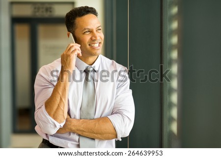 portrait of successful businessman talking on cell phone - stock photo