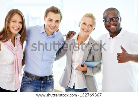 Portrait of successful friends doing business together - stock photo