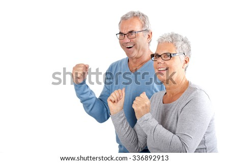 portrait of successful mature couple cheering on white Background, age and people concept - happy senior couple  - stock photo