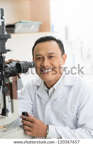 Portrait of successful oculist looking at camera - stock photo