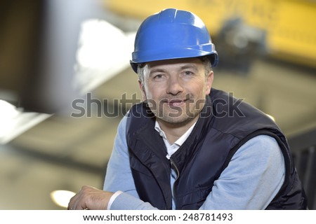 Portrait of supervisor in industrial factory - stock photo
