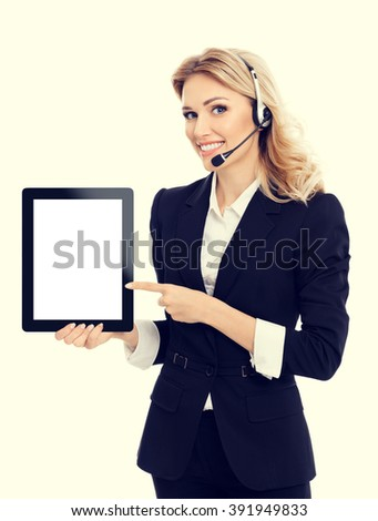 Portrait of support phone operator in headset showing blank no-name tablet pc monitor, with copyspace area for text or slogan - stock photo