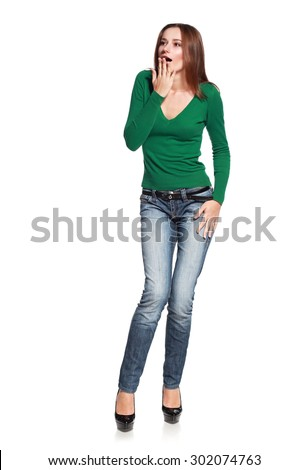 Portrait of surprised beautiful woman holding her head in amazement and open mouthed. Isolated on white. - stock photo