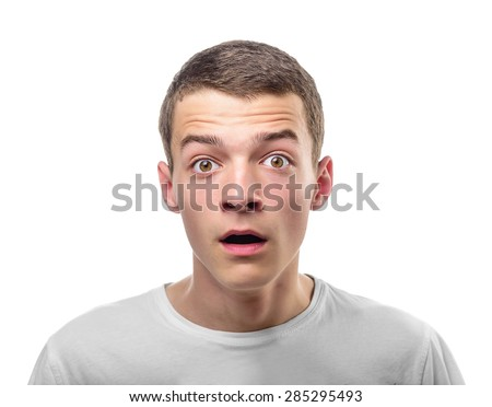 Portrait of Surprised Young Man. Isolated on white. - stock photo