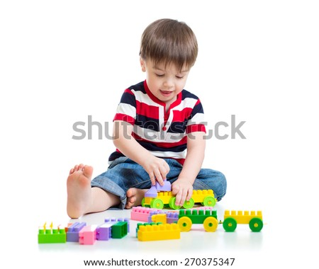 Portrait of sweet child little boy with toy blocks - stock photo