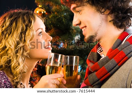 Portrait of sweet couple gazing at each other - stock photo
