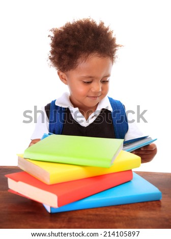 Portrait of sweet little black boy reading books isolated on white background, preparation to go to first class, back to school concept - stock photo