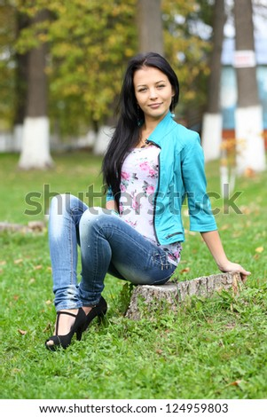 Portrait of sweet young woman enjoying at the park - Outdoor - stock photo