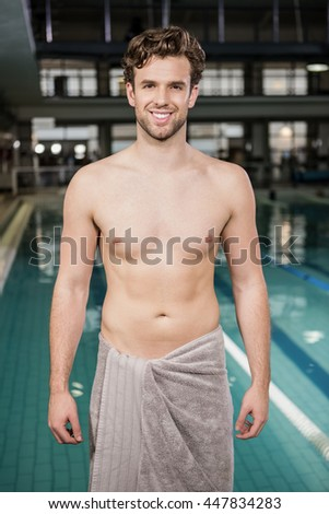 Portrait of swimmer standing near pool at the leisure center - stock photo