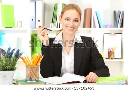 Portrait of teacher woman working in classroom - stock photo